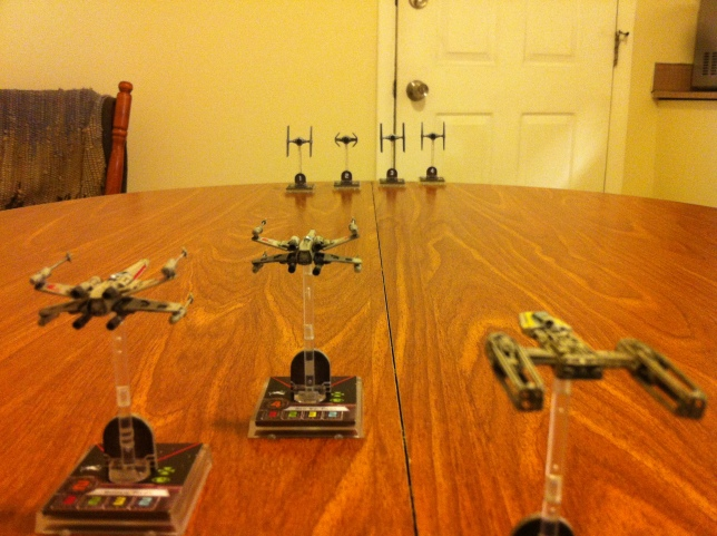 Scout Squadron faces off with four TIE Fighters.