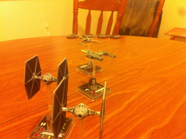 TIE Fighters bear down on Scout Three.