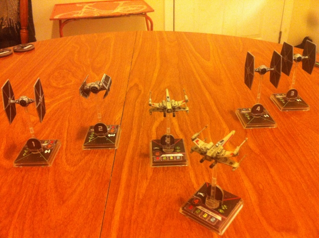 TIE Fighters race past our X-Wings.